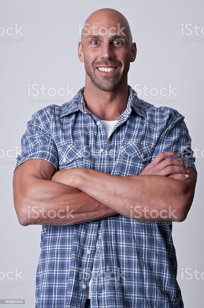 smiling man with arms crossed royalty-free stock photo