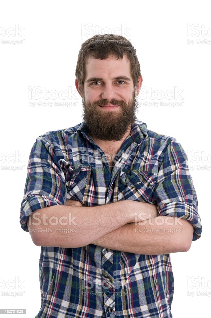 Smiling man with beard and arms crossed royalty-free stock photo