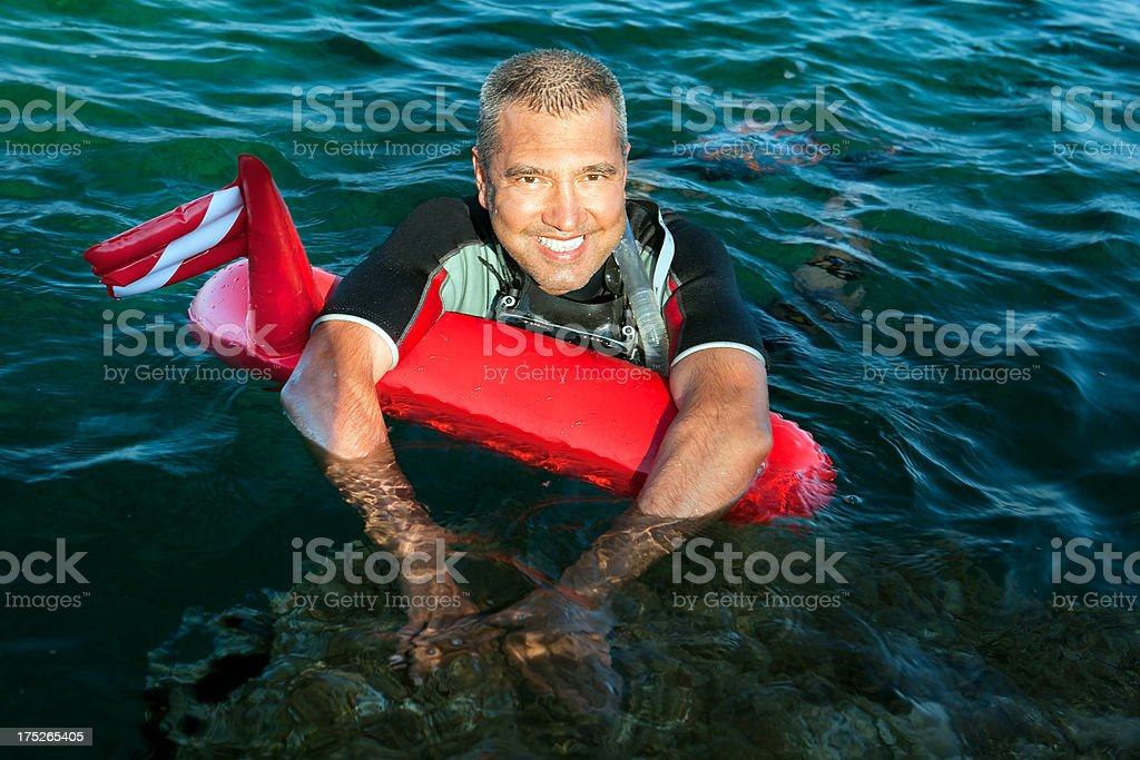 Smiling man with buoy and wetsuit royalty-free stock photo