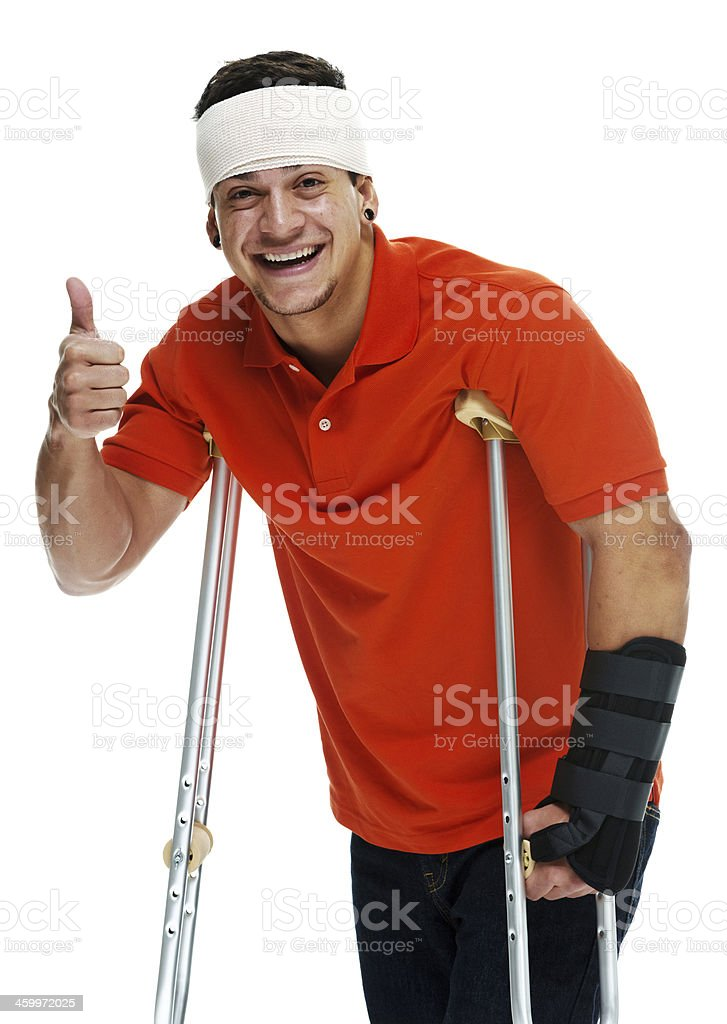 Smiling man with crutches and bandage stock photo