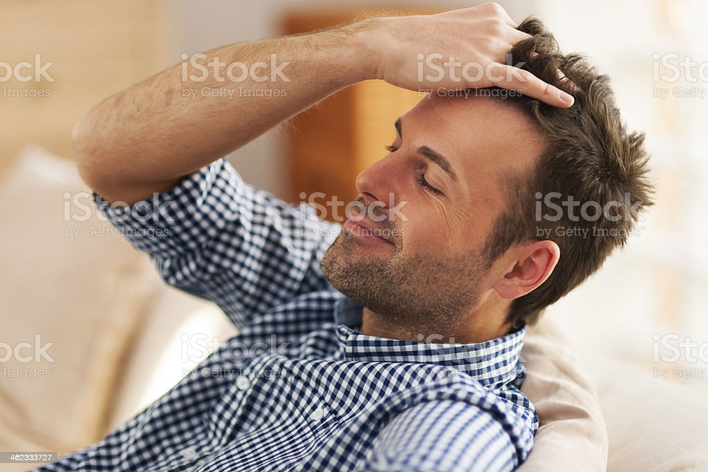Smiling man with hand in hair stock photo