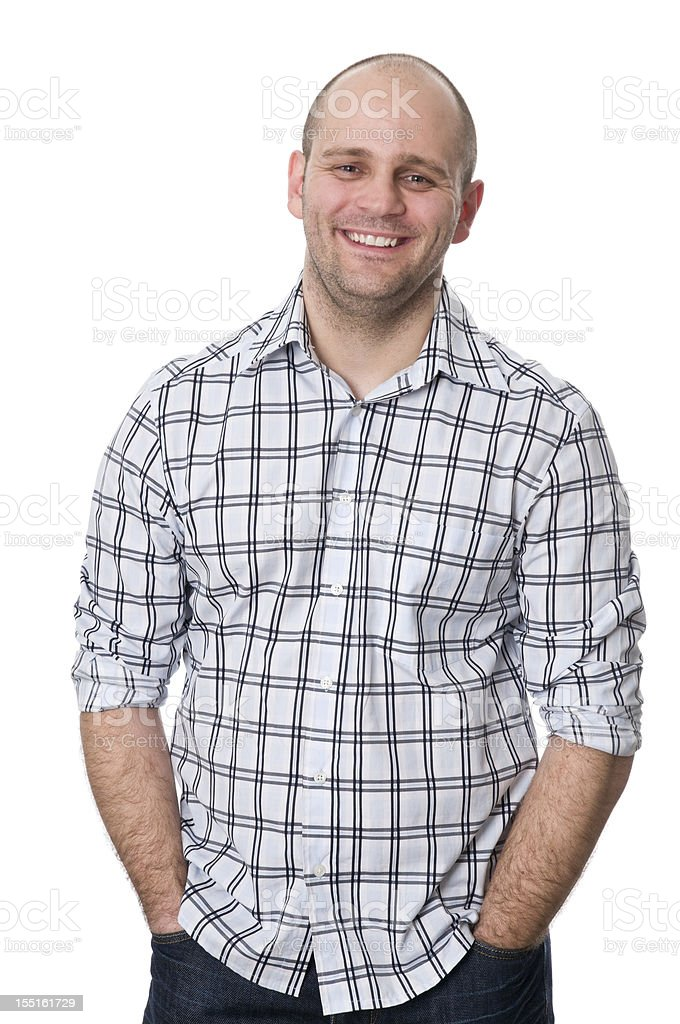 smiling man with hands in pockets royalty-free stock photo