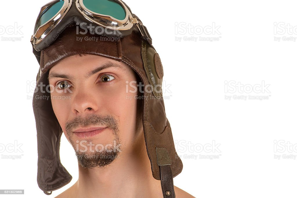 smiling man with mad look in flight helmet and goggles stock photo