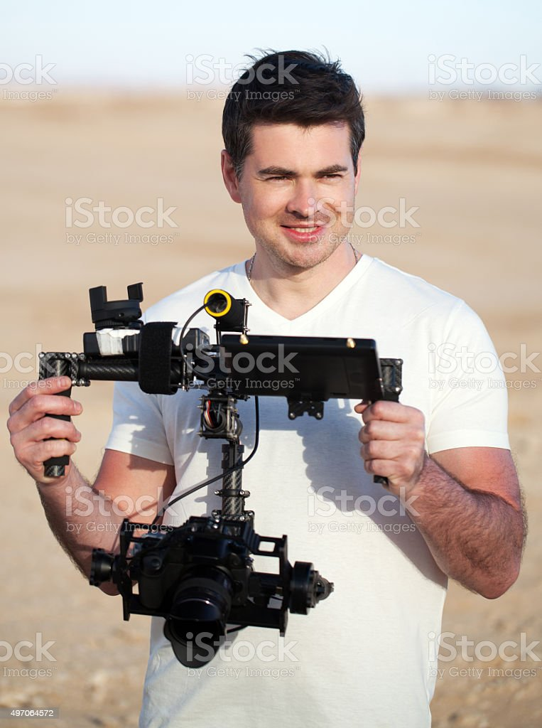 Smiling man with steadicam equipment outdoor stock photo