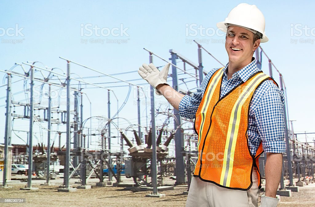 Smiling manager presenting in power station stock photo
