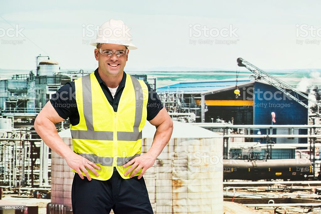 Smiling manager standing in oil industry stock photo