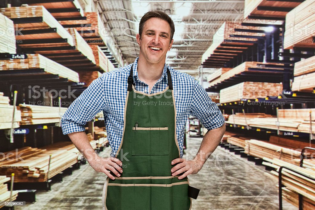 Smiling manager standing in warehouse stock photo