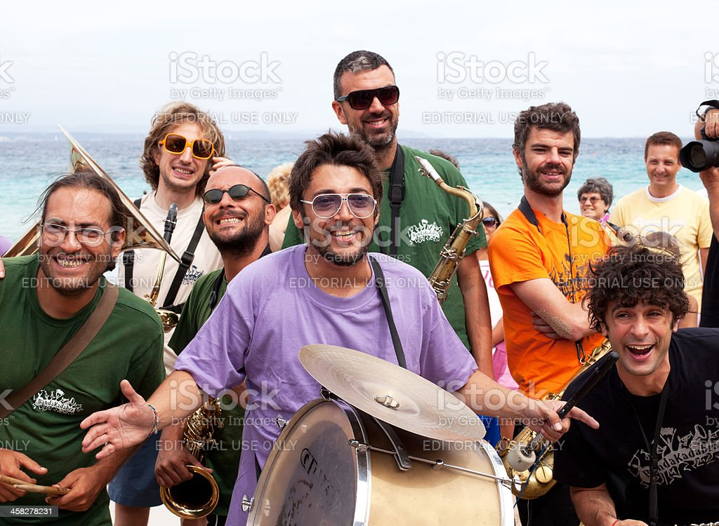 Smiling Marching Band on the beach stock photo
