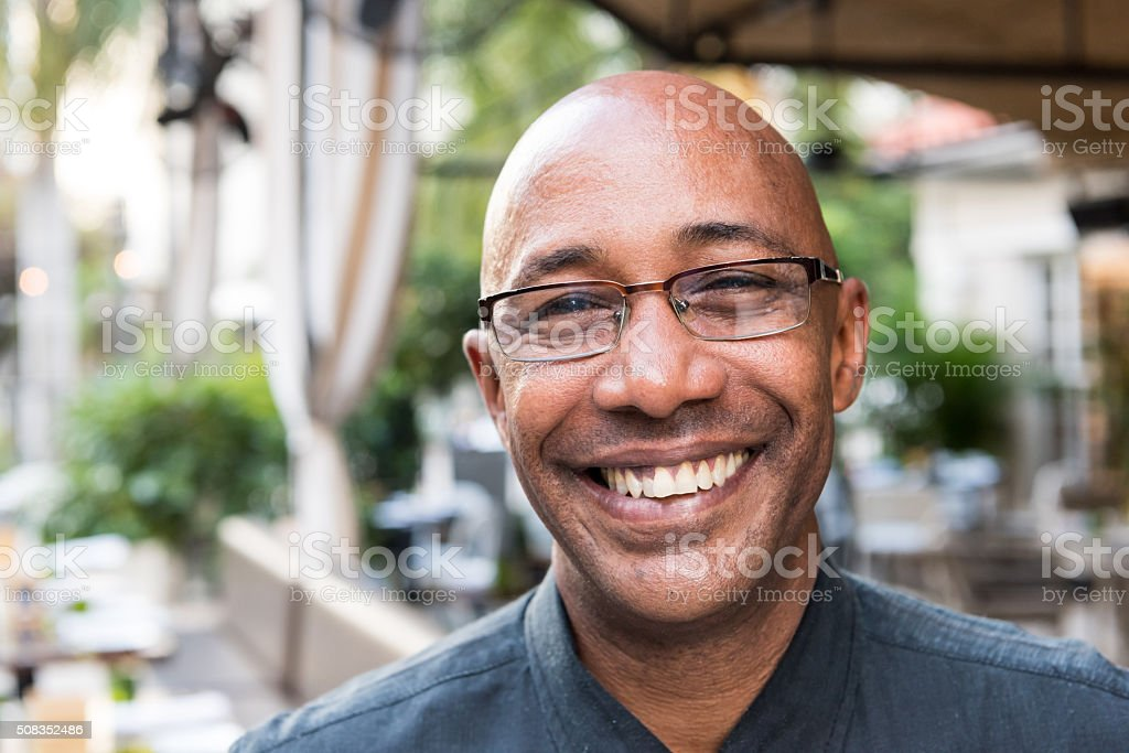 Smiling mature afro caribbean man stock photo