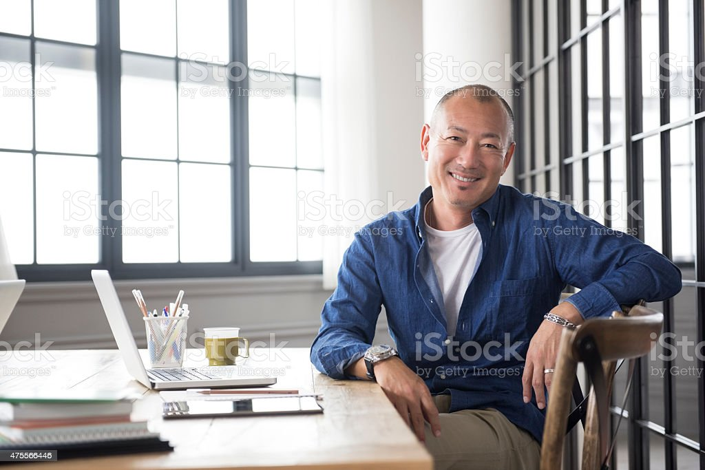 Smiling mature Asian man portrait stock photo