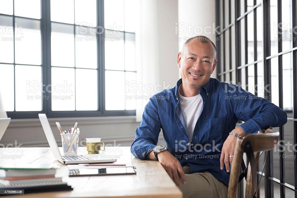 Smiling mature Asian man portrait stock photo