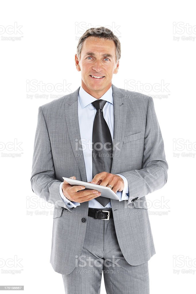 Smiling mature businessman holding a tablet PC royalty-free stock photo