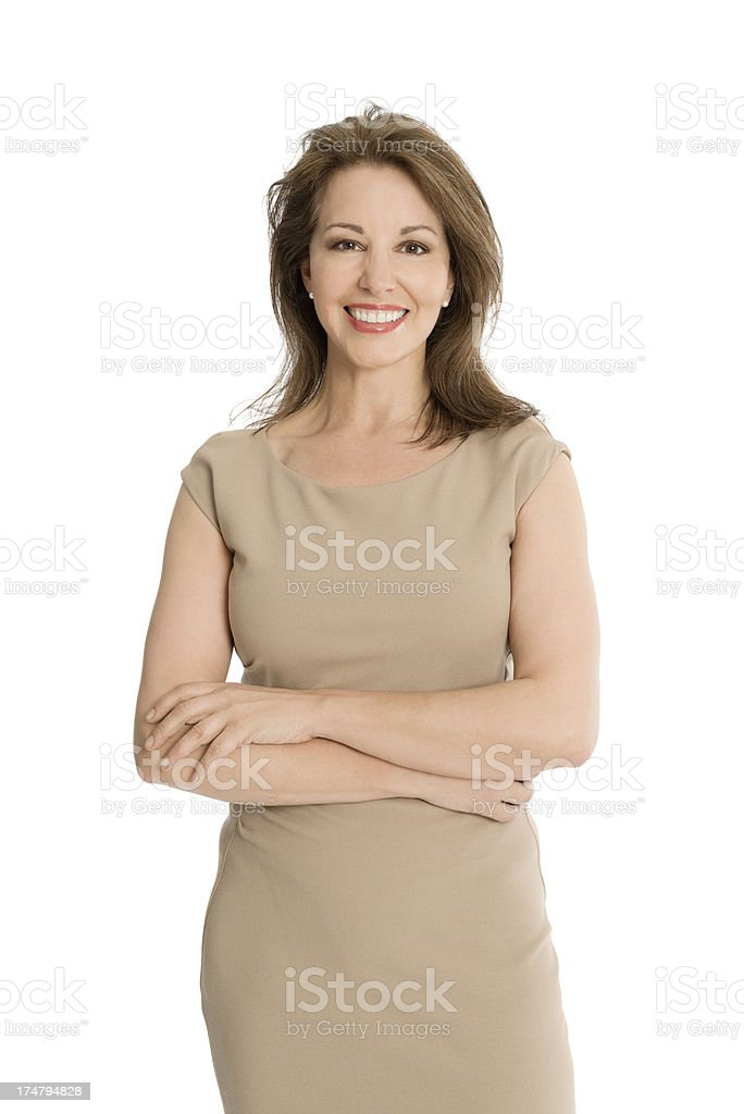 Smiling Mature Businesswoman In Dress With Arms Crossed royalty-free stock photo