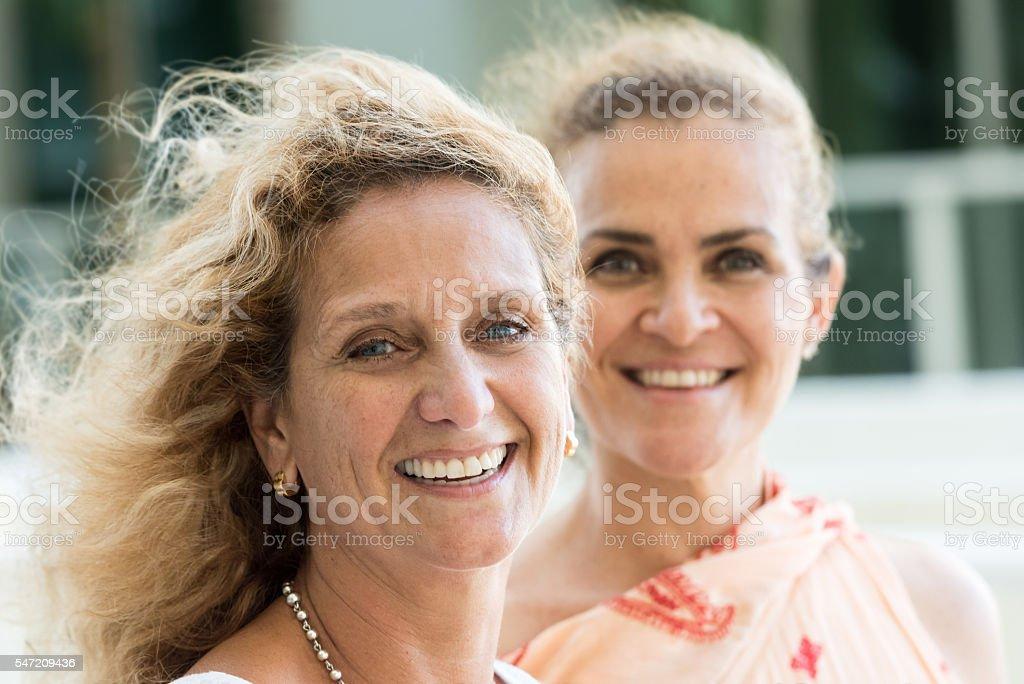 Smiling mature caucasian siblings stock photo