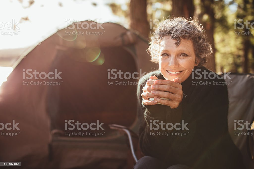 Smiling mature couple on camping stock photo