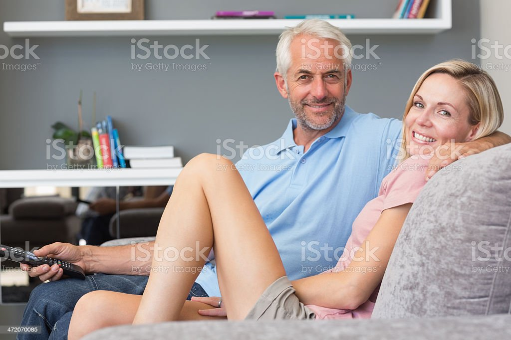 Smiling mature couple watching television royalty-free stock photo