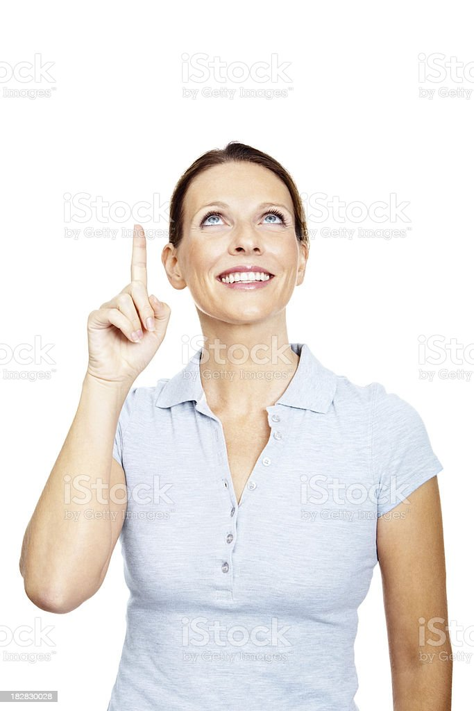 Smiling mature female pointing up at copy space royalty-free stock photo