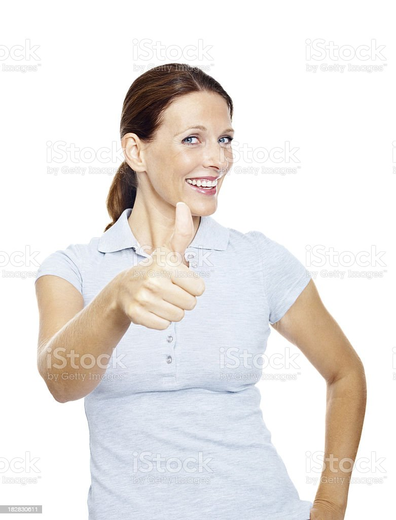 Smiling mature female showing you thumbs up sign royalty-free stock photo