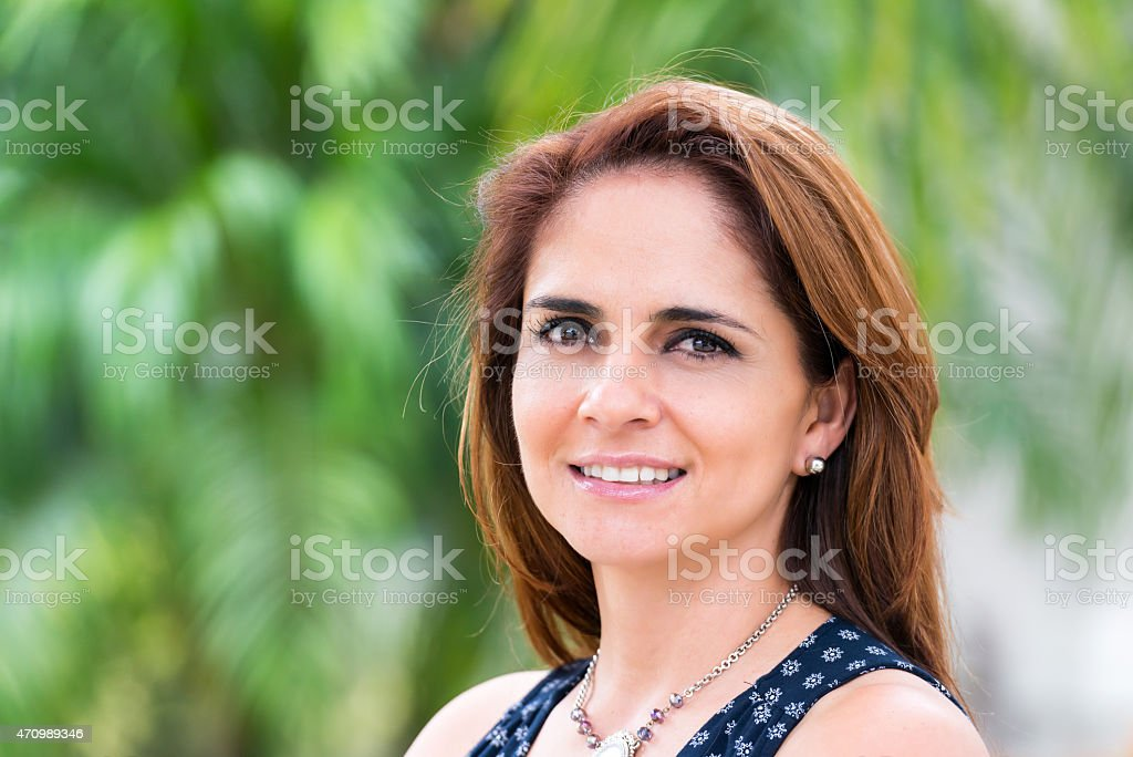 Smiling mature hispanic woman stock photo