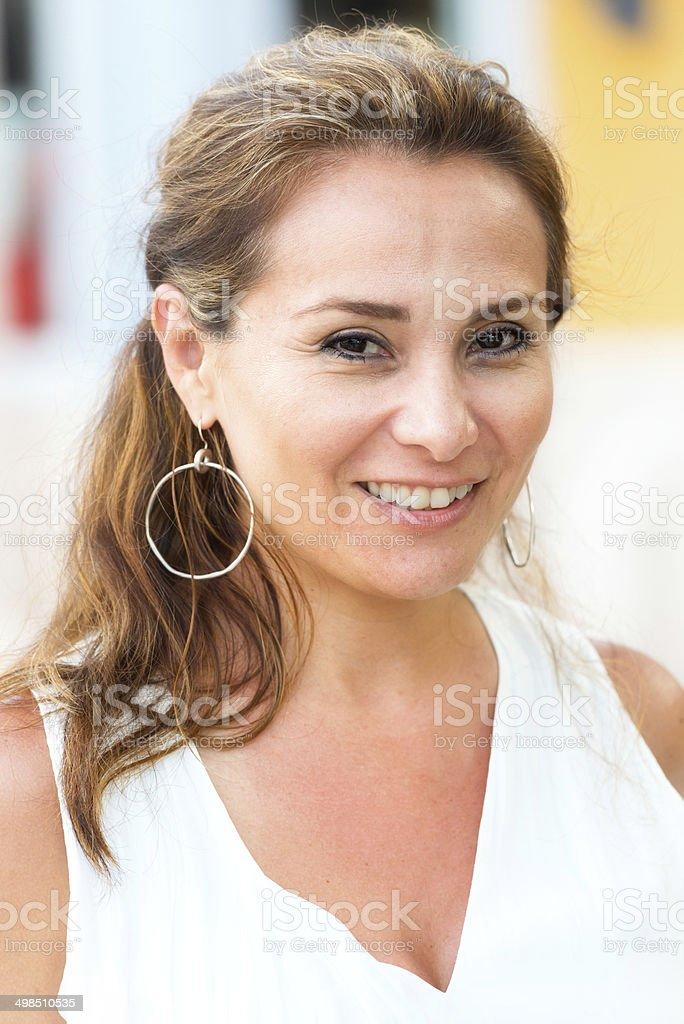 Smiling mature hispanic woman stock photo