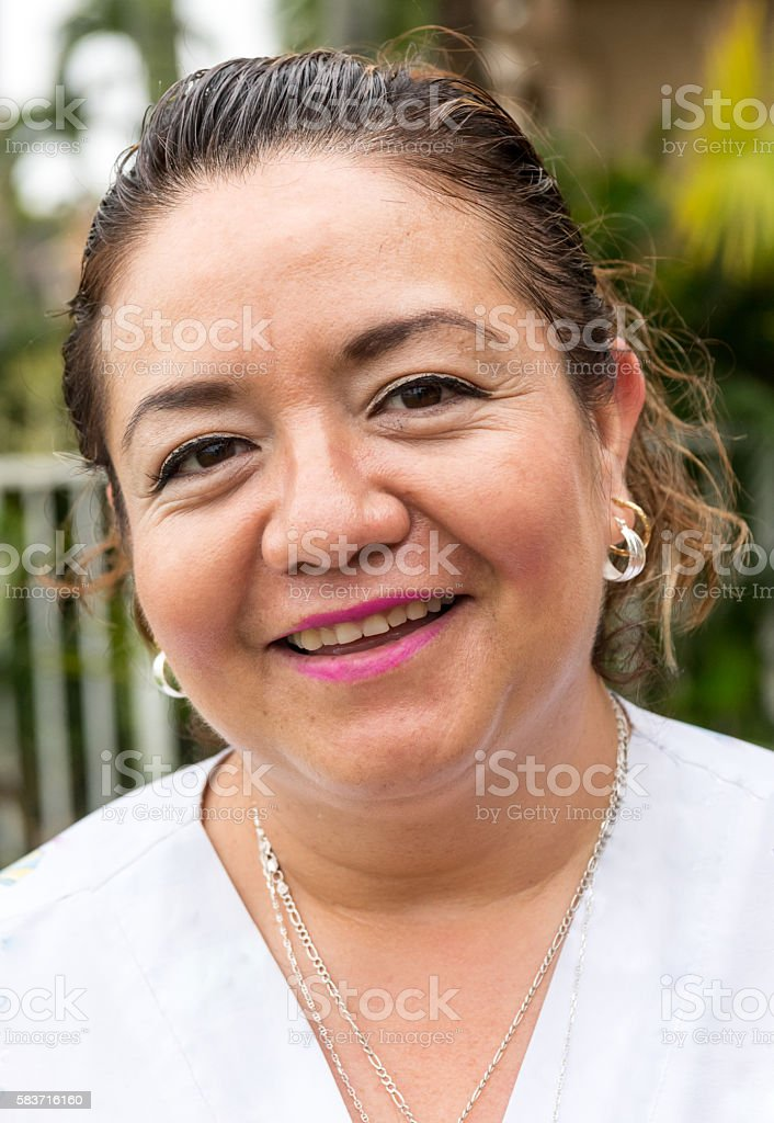 Smiling mature housewife stock photo