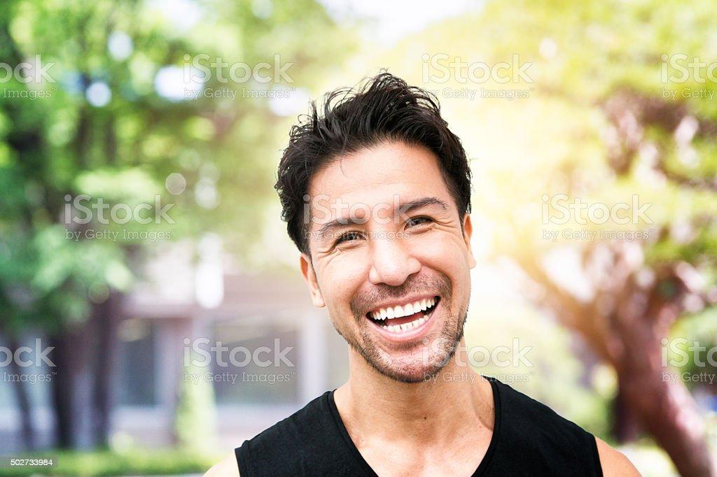 Smiling mature Japanese man portrait in Tokyo park stock photo