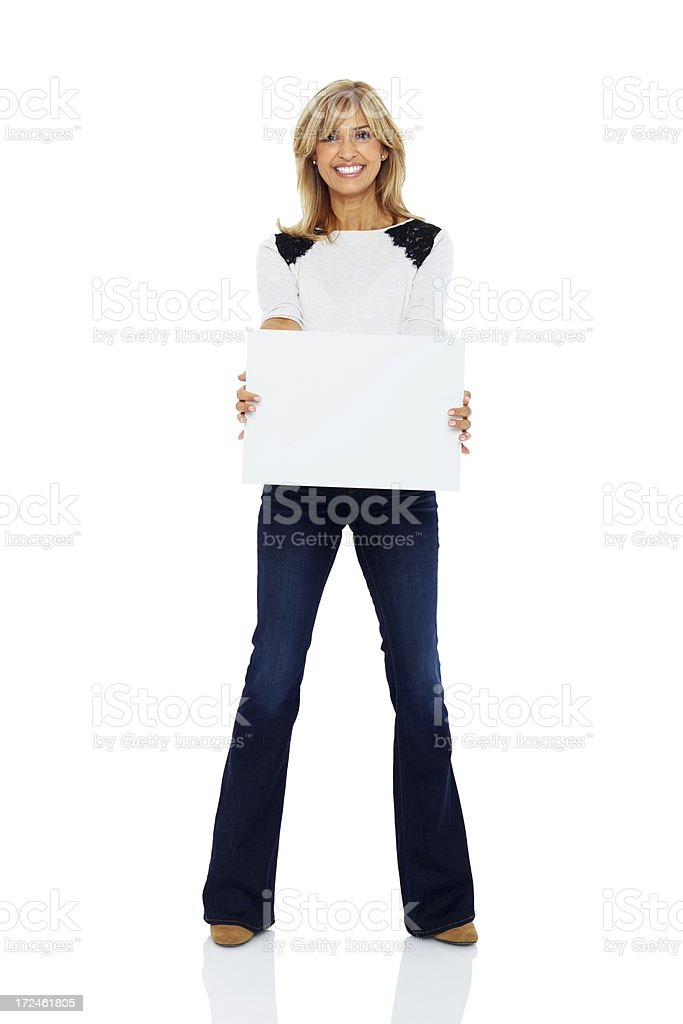 Smiling mature lady holding a blank billboard royalty-free stock photo