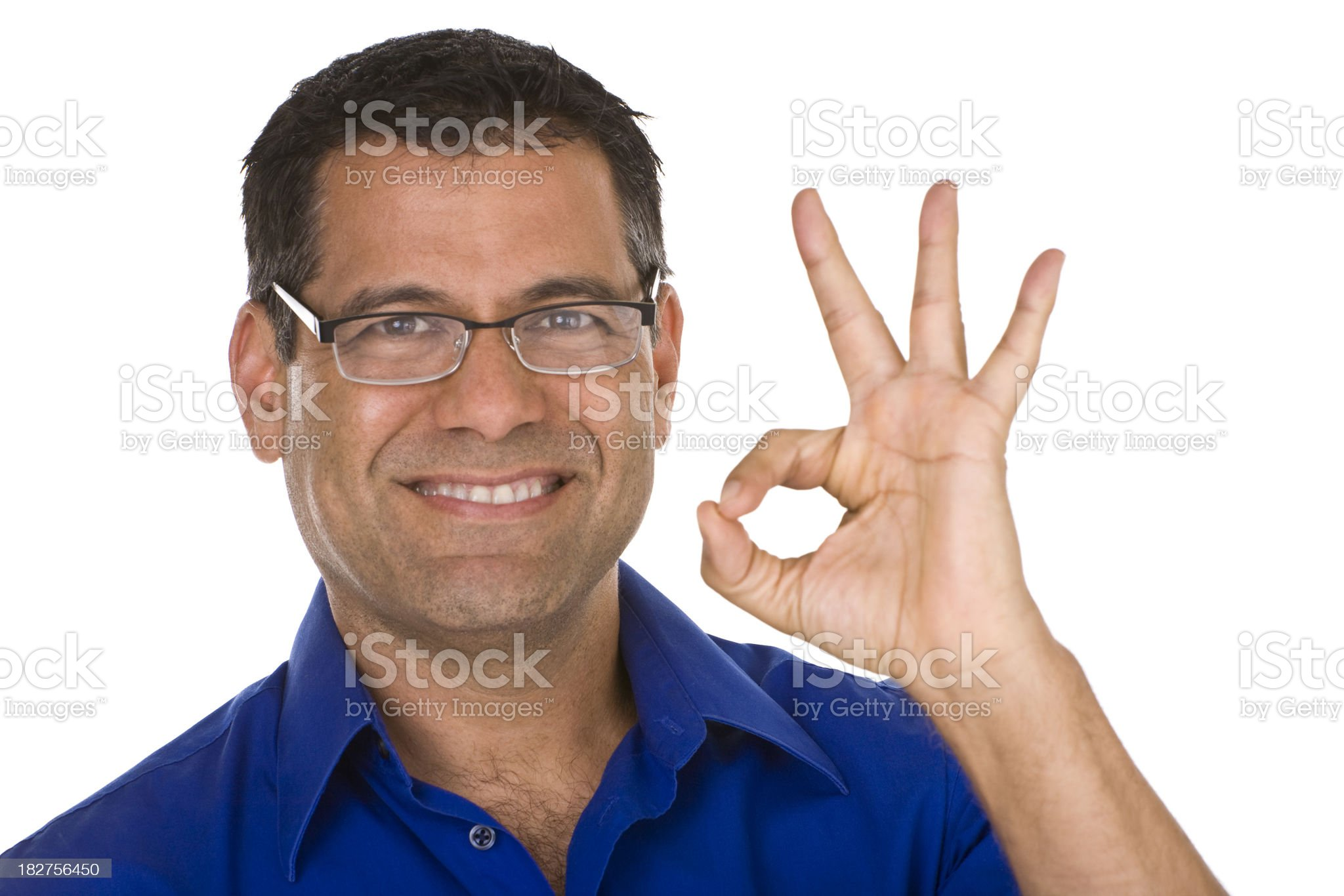 Smiling mature male wearing glasses gesturing okay sign royalty-free stock photo