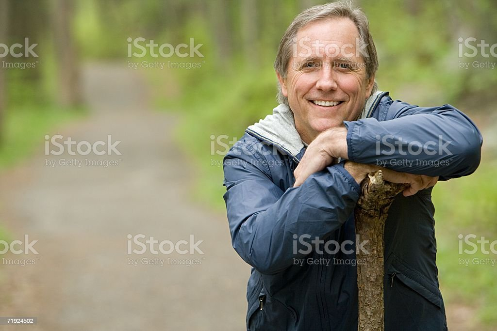 Smiling mature man in a forest royalty-free stock photo