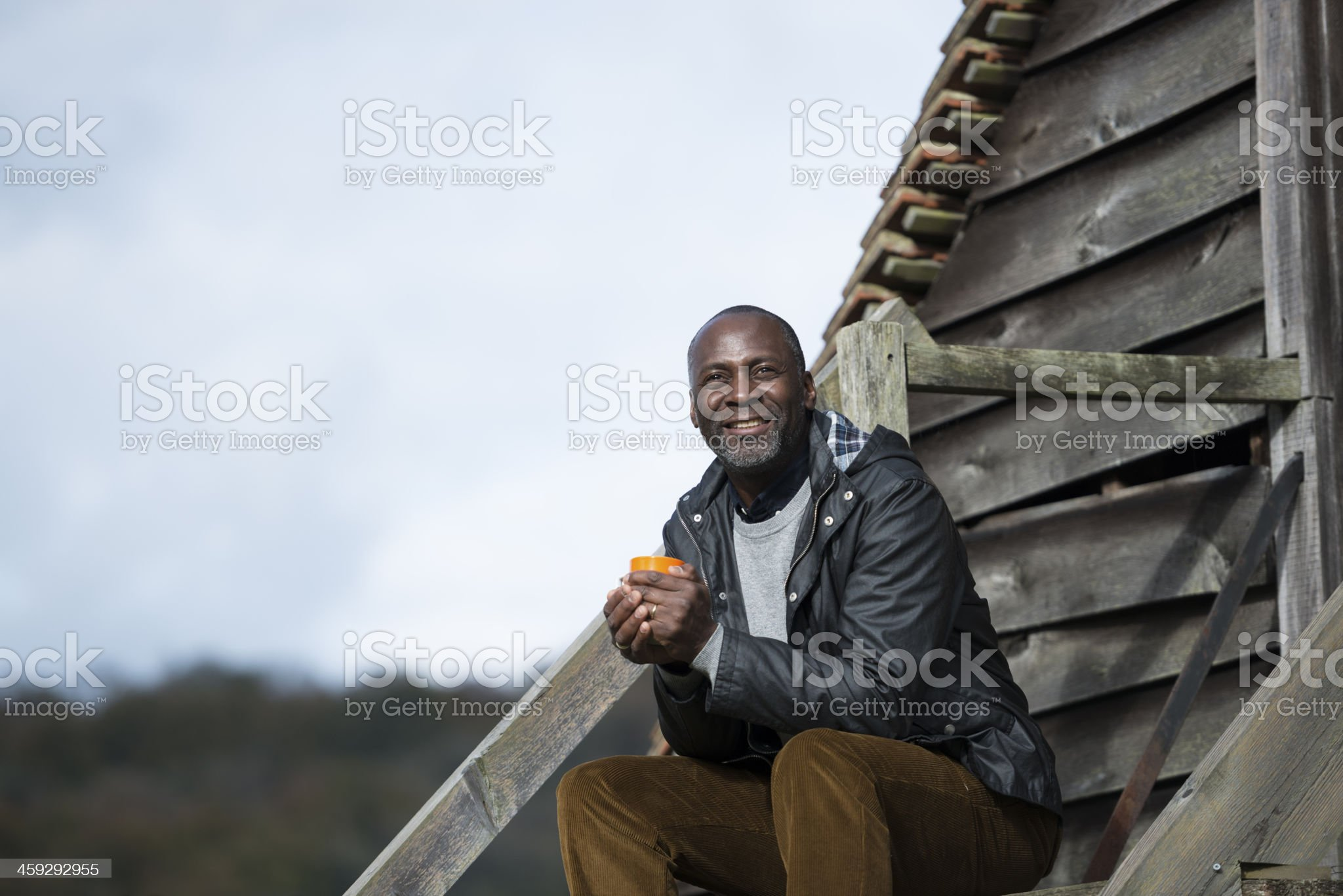 Smiling Mature Man relaxing outdoors royalty-free stock photo