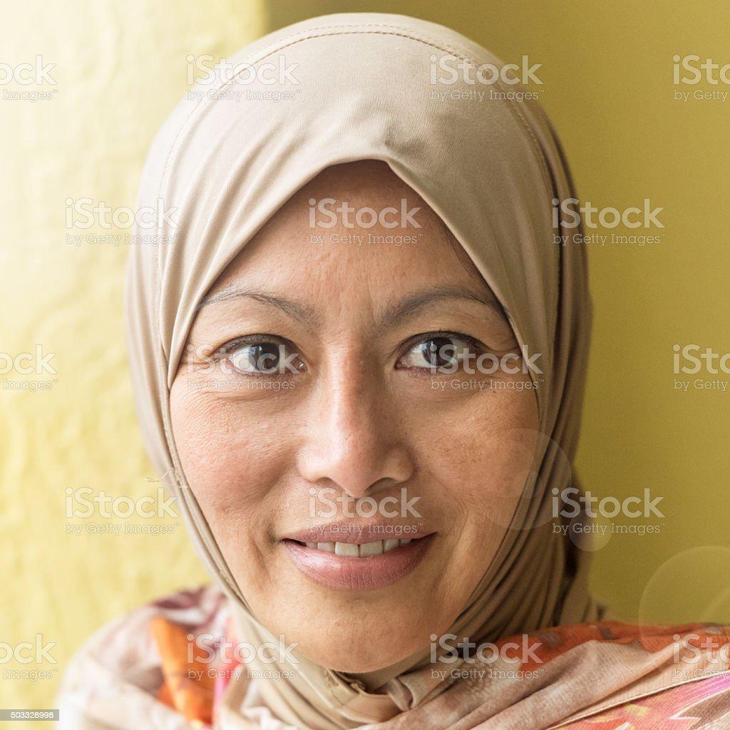 Smiling Mature Muslim woman looking at Camera stock photo