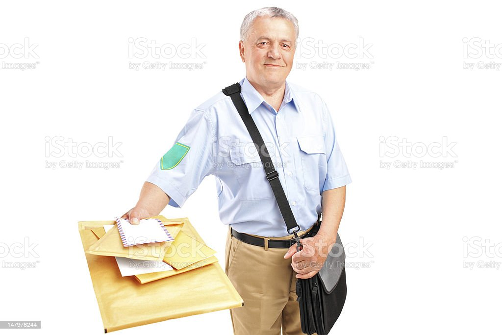 Smiling mature postman delivering letters stock photo