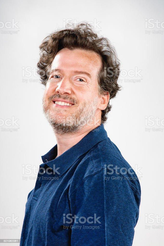 Smiling mature sunburnt bearded man studio portrait stock photo