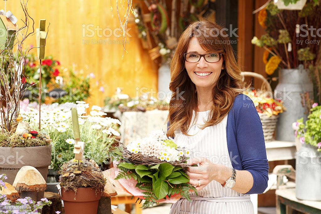 Smiling Mature Woman Florist Small Business Flower Shop Owner stock photo