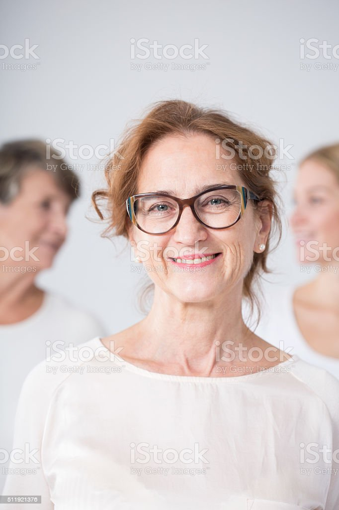 Smiling mature woman in glasses stock photo