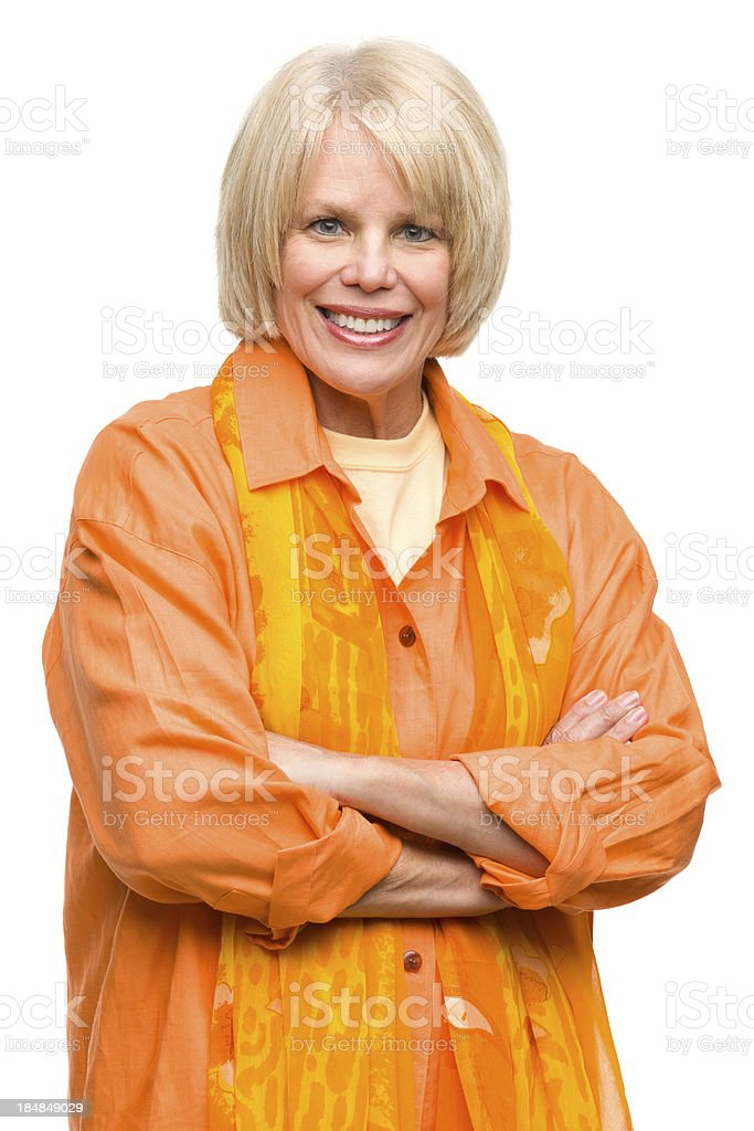 Smiling Mature Woman Posing With Arms Crossed royalty-free stock photo