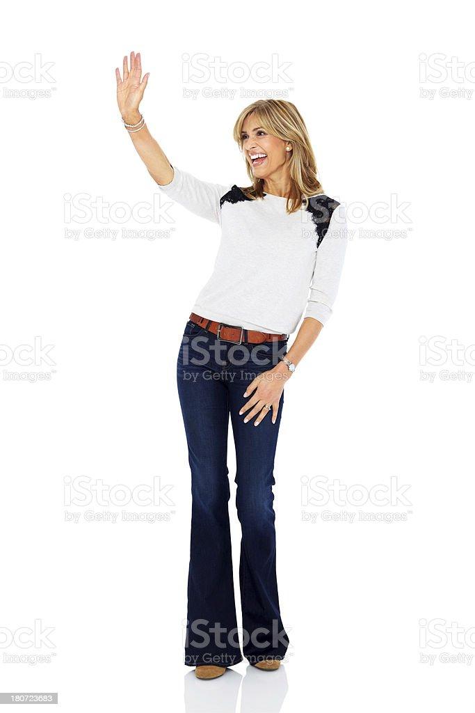Smiling mature woman waving at copyspace royalty-free stock photo