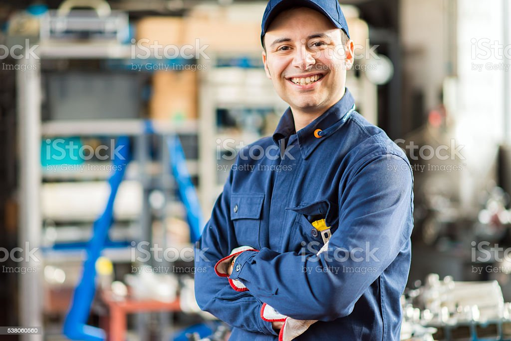 Smiling mechanic portrait stock photo
