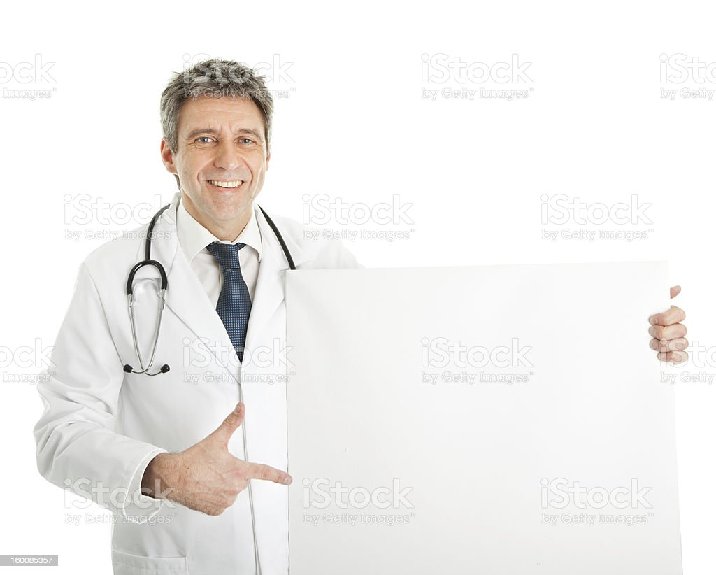 Smiling medical doctor presenting empty board royalty-free stock photo