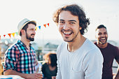 Smiling men on a party
