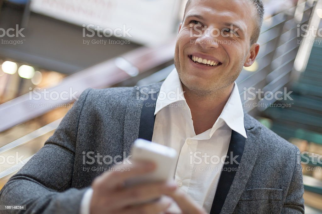 Smiling men with smartphone in business building stock photo