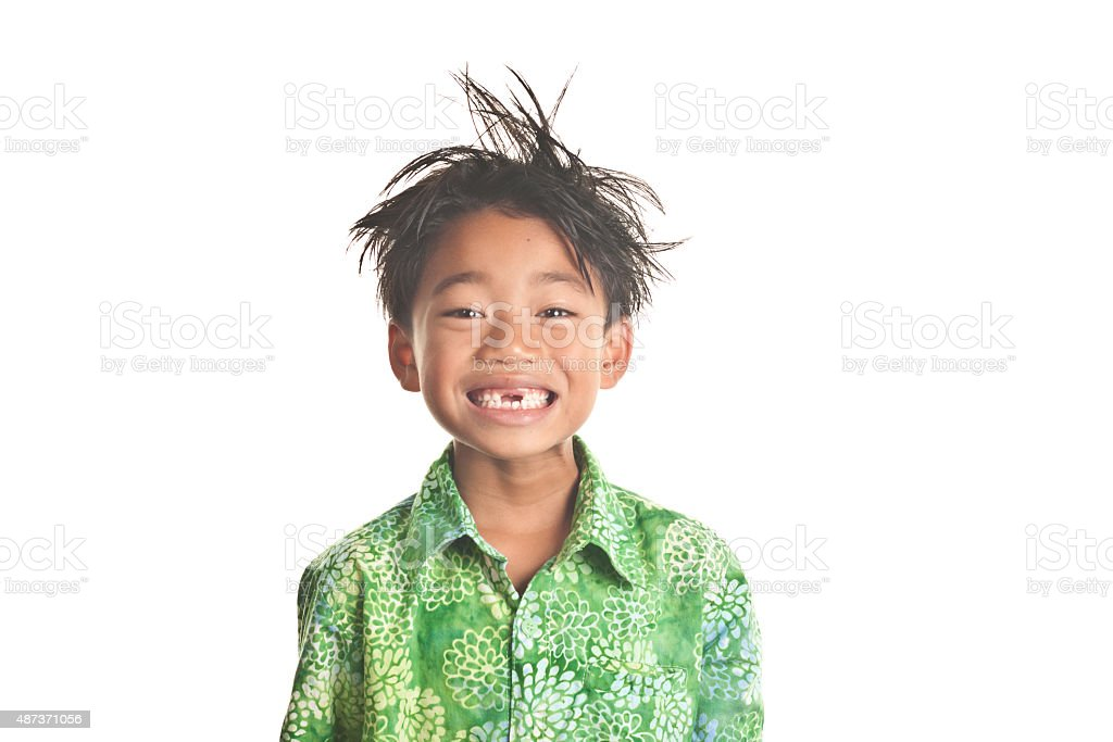 Smiling messy hair child with missing front teeth stock photo