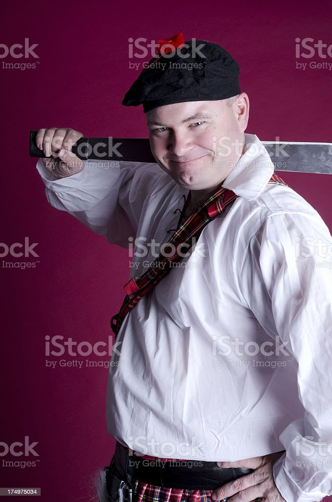 Smiling mid adult man in Scottish costume royalty-free stock photo