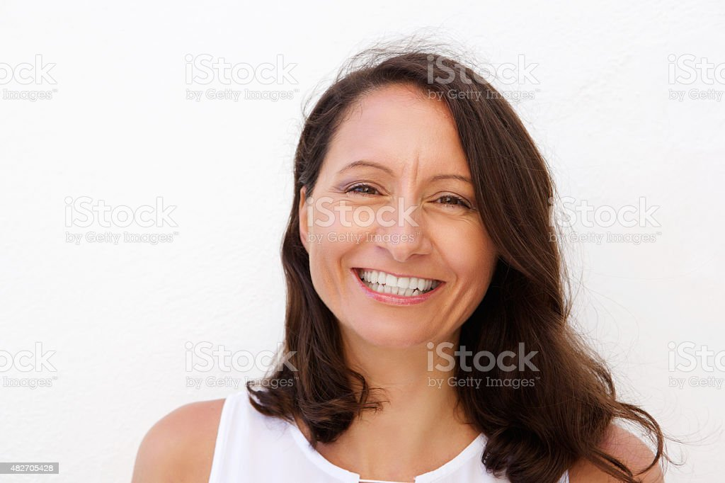 Smiling mid adult woman stock photo