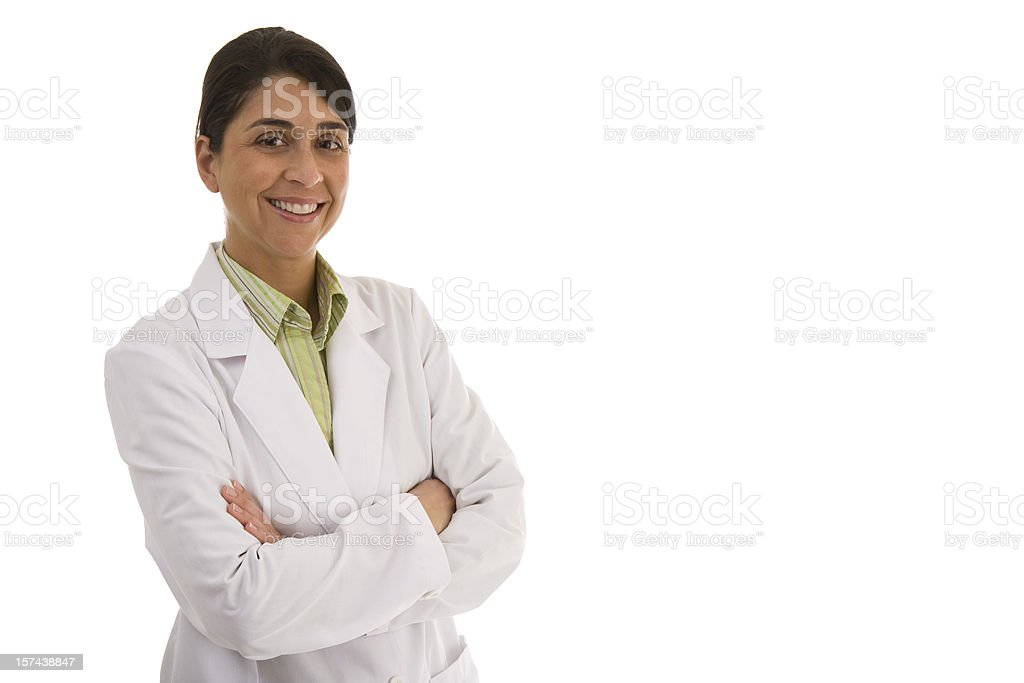 Smiling mid adult woman wearing lab coat arms crossed royalty-free stock photo