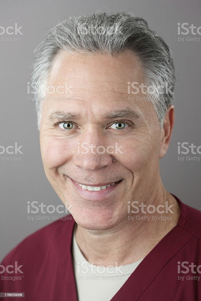 Smiling middle age male doctor royalty-free stock photo