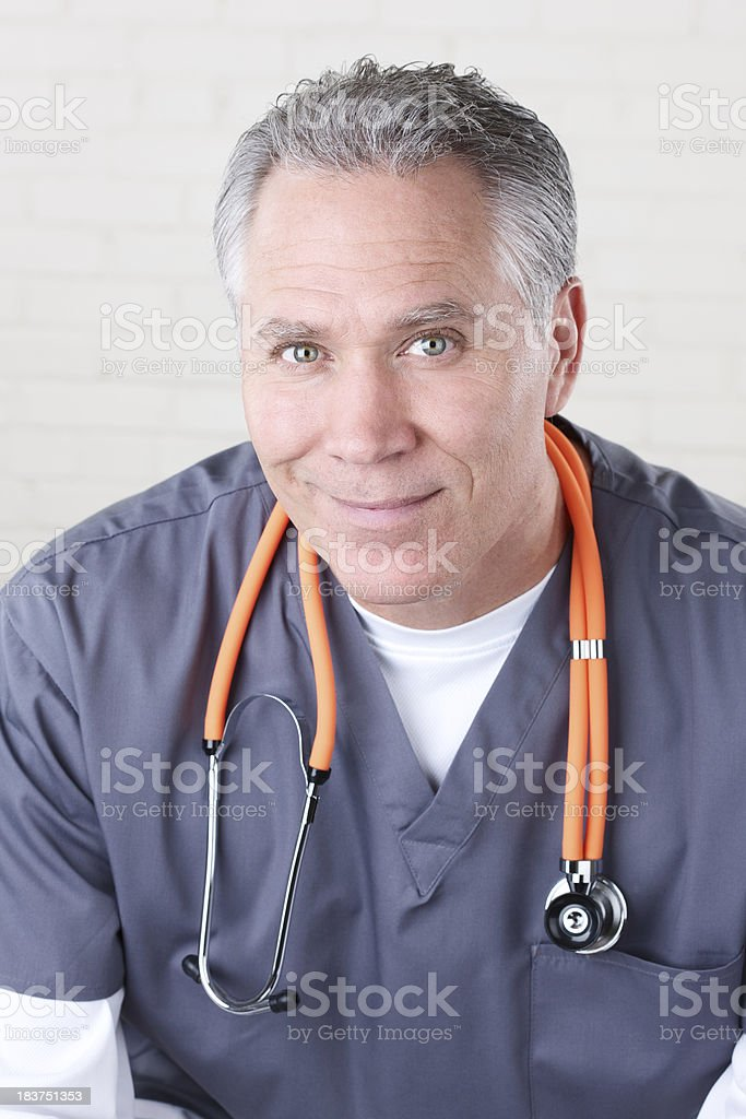 Smiling middle age male health care worker royalty-free stock photo
