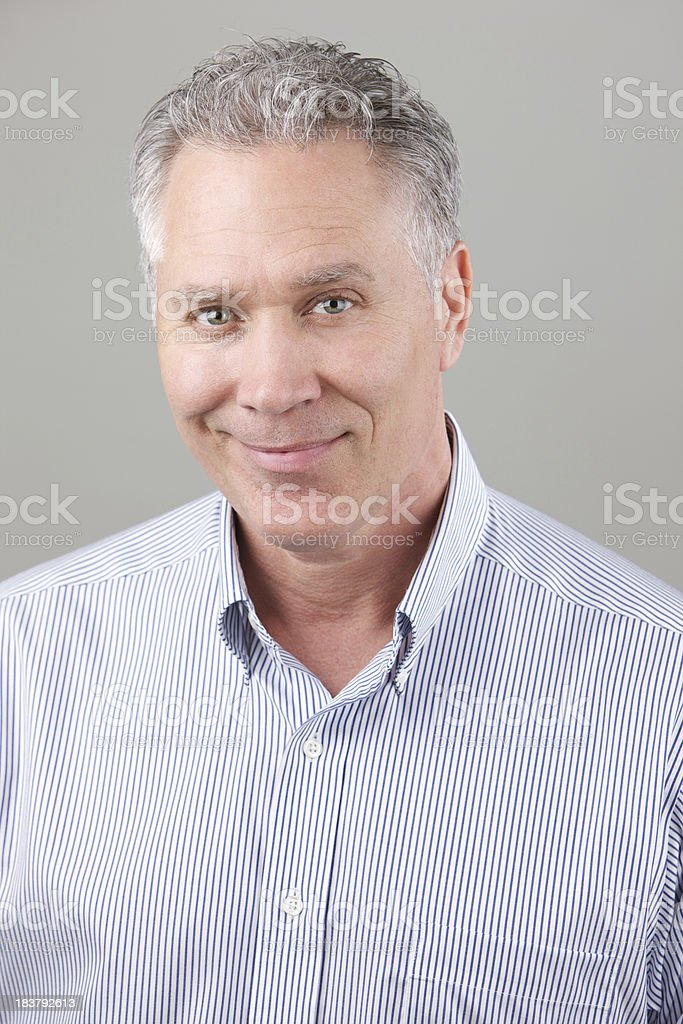 Smiling middle age man with blue stripe shirt stock photo