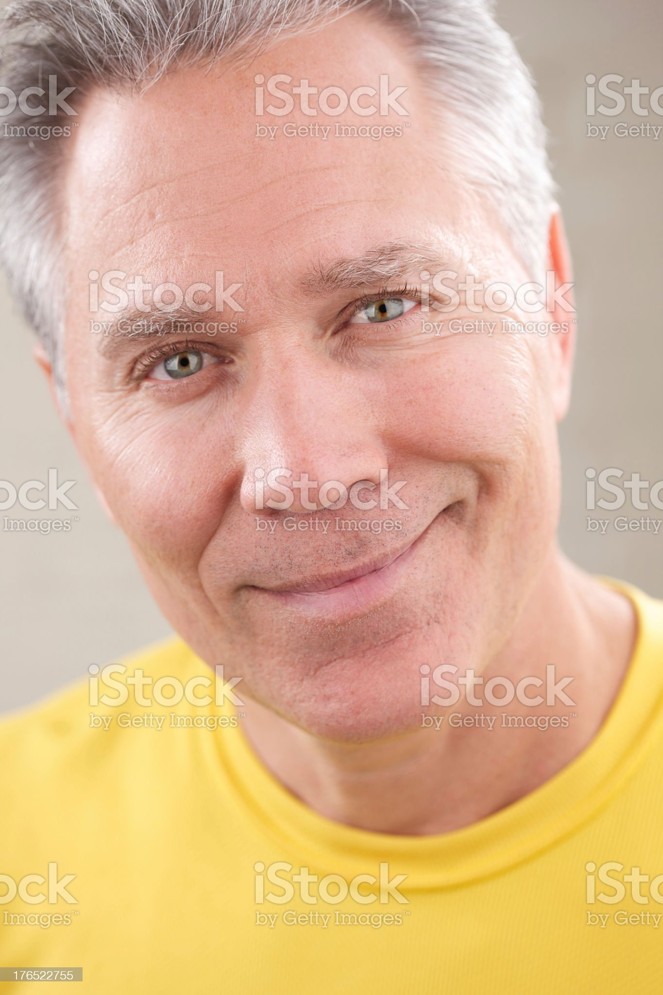 Smiling middle age man with gray hair royalty-free stock photo