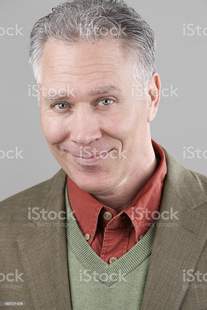 Smiling middle age man with green linen sport coat royalty-free stock photo